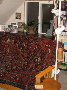 The futon with a Russian rug as a cover, faces the desk and the wall where it used to be.