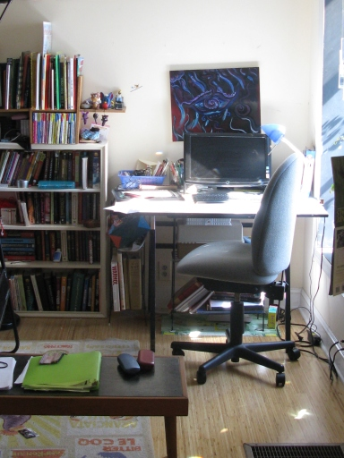 A workstation now occupies the wall that faced the door.